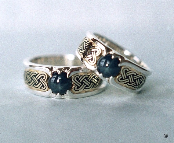 Double lined Silver and Yellow Gold Celtic Heart Shield Rings, set with blue star Sapphires