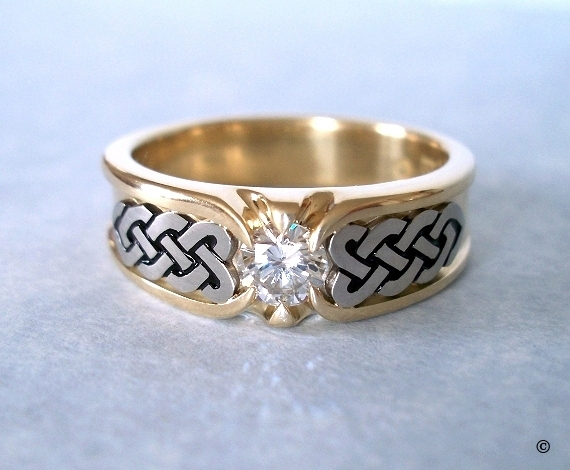 Yellow and White Gold Celtic Heart Shield Ring, with a flush set .33ct Diamond