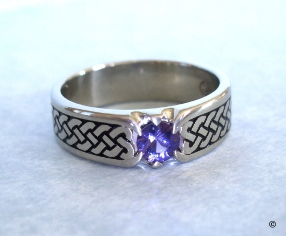 White Gold Narrow Celtic Heart Shield Eternity Band flush set with a .25ct purple Sapphire