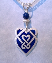 Celtic Heart Shield Pendant In Silver