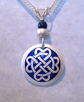 Celtic Heart Circle Pendant In Silver