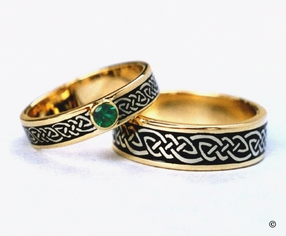 Celtic Bonding Knot Rings, 15K Yellow Gold Bands with White Gold Knots and a bezel set.25ct Emerald