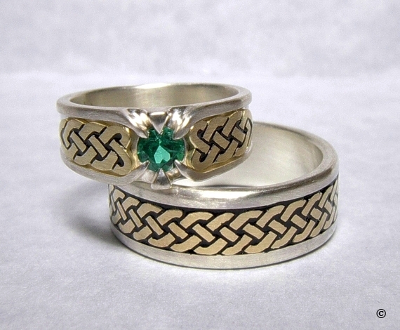 Silver and Yellow Gold Celtic Heart Shield Rings, flush set with a .50ct Emerald