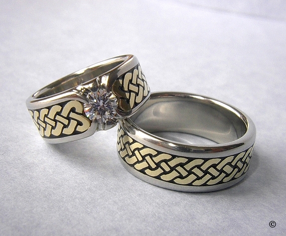 White and Yellow Gold Celtic Eternity Heart Shield Rings, with a flush set .50ct Diamond